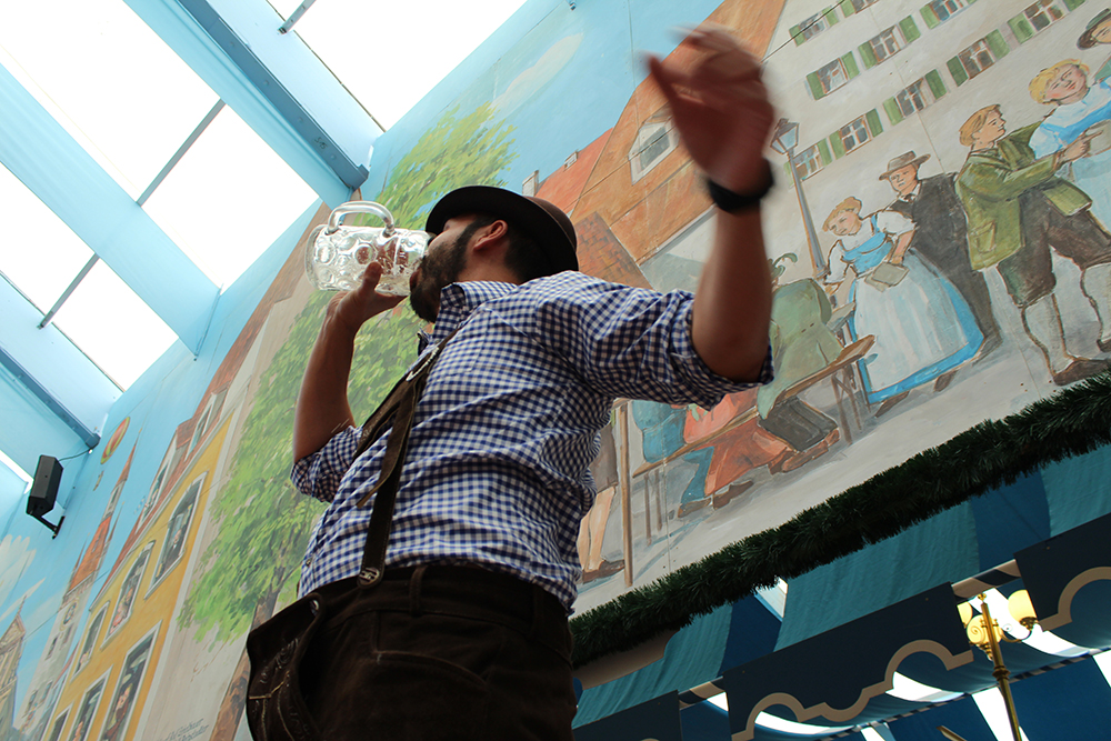 Man drinking at the Oktoberfest, by Packing my Suitcase